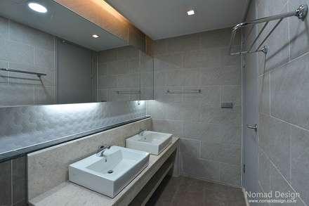 66평 엘크루블루오션 - 부산: 노마드디자인 / Nomad design의  화장실