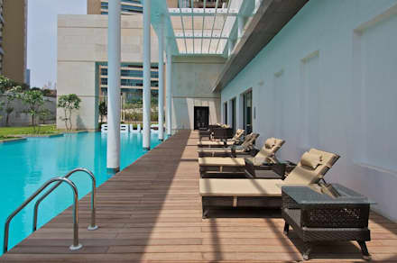 Lodha Bellissimo Clubhouse:  Garden Pool by Racheta Interiors Pvt Limited