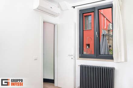 B&B: Finestre in PVC in stile  di Gruppo Infissi