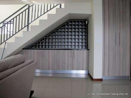 The Under-Stairs Wine Rack: modern Kitchen by Drake Williams Decor