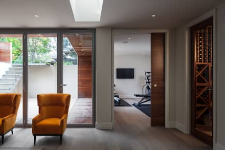 Basement gym and wine cellar: modern Gym by Thomas & Spiers Architects