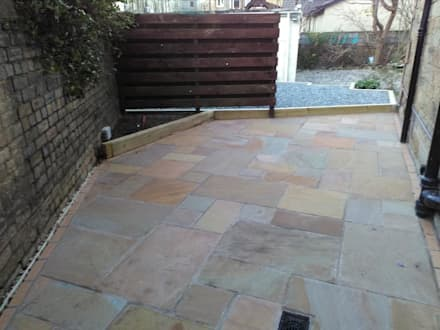A garden patio with raised bed/:  Front garden by Colinton Gardening Services - garden landscaping for Edinburgh