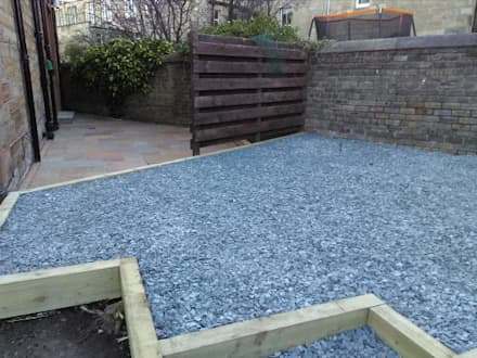 slate patio bordered with wooden sleepers:  Front garden by Colinton Gardening Services - garden landscaping for Edinburgh