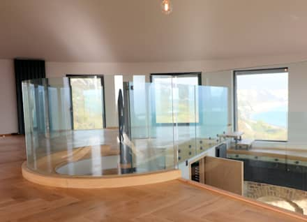 Curved glass balustrade in heritage tower home :  Stairs by Ion Glass