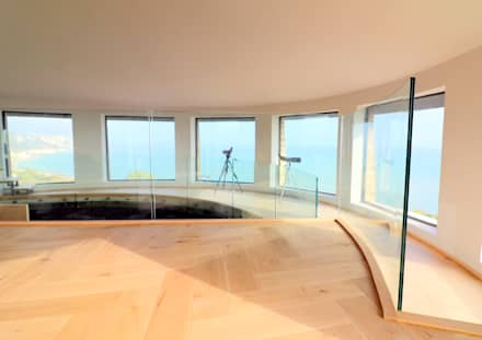 Curved glass balustrade in heritage tower home :  Roof by Ion Glass