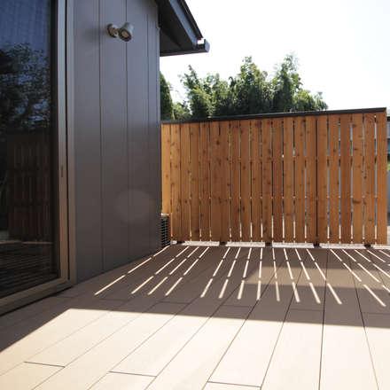 中庭: 塚野建築設計事務所が手掛けた庭です。