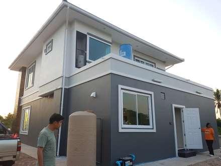 บ้านเดี่ยวสองชั้น ออกแบบและเลือกวัสดุตามใจลูกค้า:  บ้านและที่อยู่อาศัย by บริษัท ซายแอค คอนทรัคชั่น จำกัด