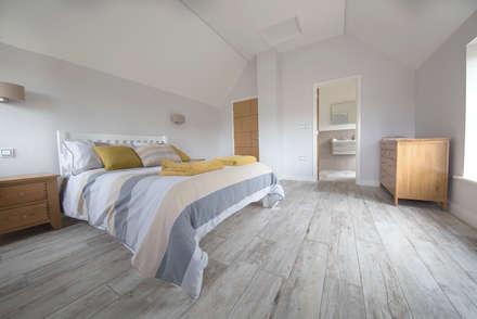 Coastal Rebuild: Pebbleshore Wood Effect Porcelain: scandinavian Bedroom by Quorn Stone