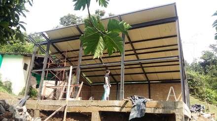 SALON DE JUEGOS PRIVADO:  Country house by BTM INVERSIONES SAS