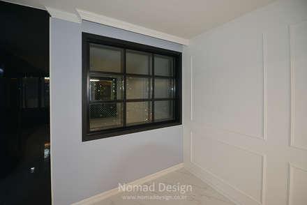 부산 다대포현대아파트 69평 인테리어: 노마드디자인 / Nomad design의  창문
