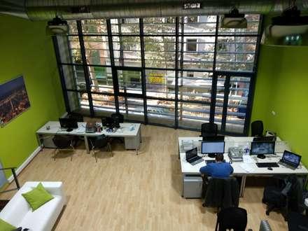 Mercanza Barcelona: Edificios de oficinas de estilo  de Unik For You sl