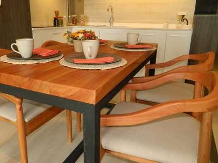 Mesa comedor diseñada y ejecutada por DDO: Comedores de estilo rústico por DDO Diseño