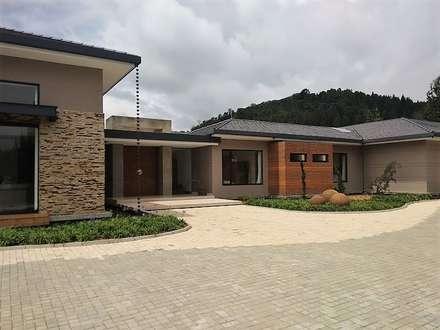 Country house by Espacios Positivos