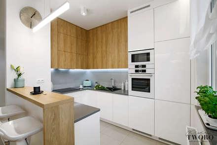Żoliborz Artystyczny Biały: styl , w kategorii Kuchnia zaprojektowany przez Klaudia Tworo Projektowanie Wnętrz Sp. z o.o.