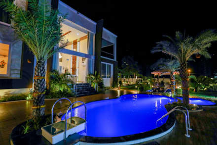 Elevation (Night View):  Swimming pond by ZEAL Arch Designs