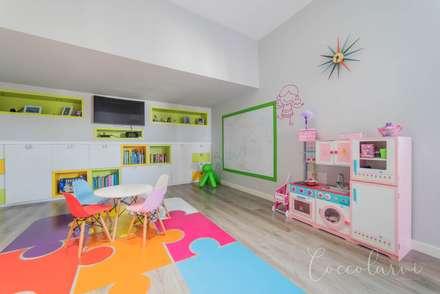 Vivienda Unifamiliar: Salas multimedia de estilo minimalista de Coccolarvi