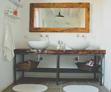Baños de estilo rural por atelier architettura
