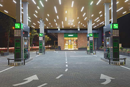 Petrol Station Renasterii: Doppio garage in stile  di Wisp Architects