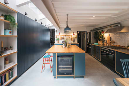 View of kitchen from dining space:  Built-in kitchens by Mustard Architects