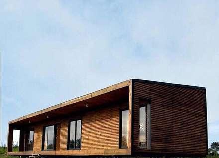 4 16 HOUSE: Casas unifamiliares de estilo  por Manuel Herrera