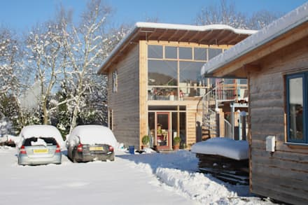 Side of Solar Passive House in the snow.:  Passive house by David Colwell Design