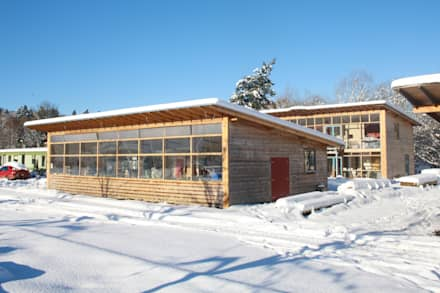 Front of Passive Workshop with Solar Passive House behind.:  Passive house by David Colwell Design