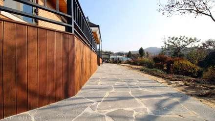 부여 석동리 전원주택 / Exterior: 에이프릴디아의  전원 주택