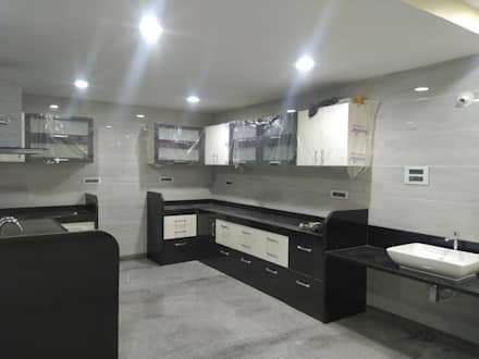 Modular Kitchen:  Kitchen units by Cfolios Design And Construction Solutions Pvt Ltd