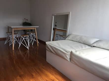 Mobiliario e interiorismo : Salas de estilo minimalista por Felipe Lara &  Cía