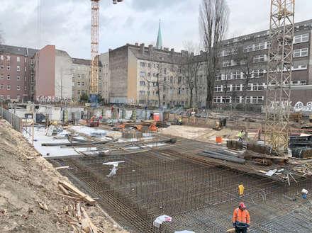 Wohnen am Leopoldplatz // Baufortschritt:  Mehrfamilienhaus von designyougo - architects and designers