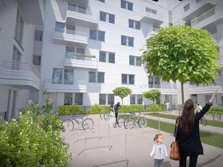 Wohnen am Leopoldplatz // Höfe:  Mehrfamilienhaus von designyougo - architects and designers