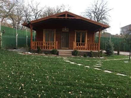 Jardines con piedras de estilo  por KAYALAR AHŞAP KERESTE ÜRÜNLERİ