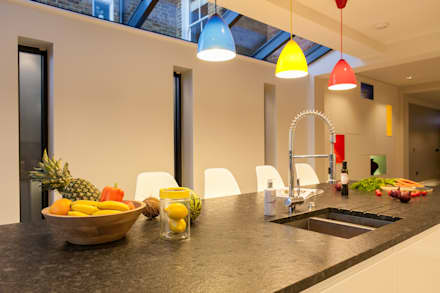 Multi-coloured kitchen ceiling pendants: minimalistic Kitchen by Timothy James Interiors