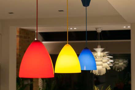 Multi-coloured kitchen pendants: minimalistic Kitchen by Timothy James Interiors