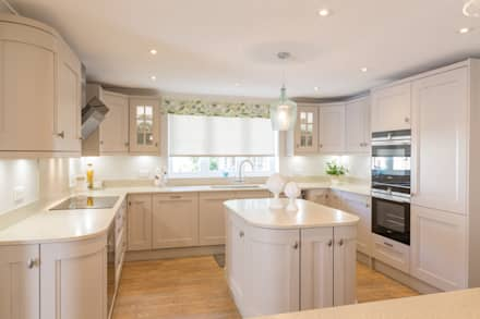 Perfect Curves Made Possible With Mistral Work-surfaces:  Built-in kitchens by Woollards of Mildenhall