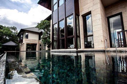tropischer Pool von MJKanny Architect