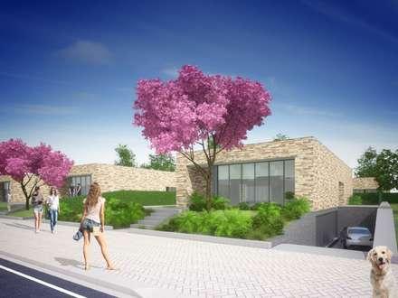 Stone House : Moradias  por Studio Deusdara
