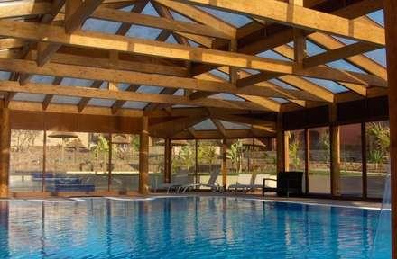 Inspirações: Piscinas infinitas  por Drevo - Construção e Reabilitação em Madeira, Unipessoal, Lda