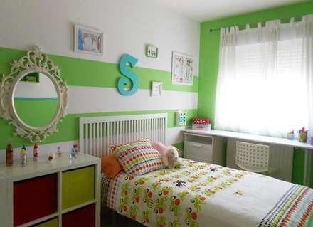 PROYECTO DE INTERIORISMO Y DECORACIÓN. DORMITORIO NIÑA: Habitaciones de niñas de estilo  de Juana Basat