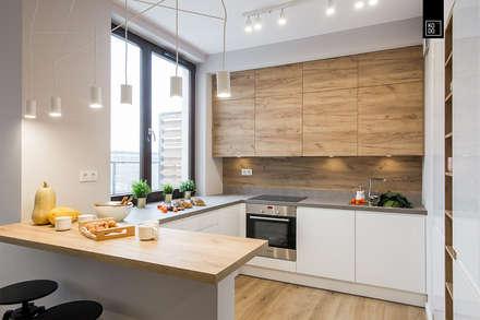 Przytulny Mokotów: styl , w kategorii Kuchnia zaprojektowany przez Pracownie Wnętrz Kodo