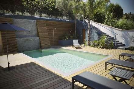 Jardim moderno: Jardins modernos por ECOSSISTEMAS; Áreas Verdes e Sistemas de Rega.