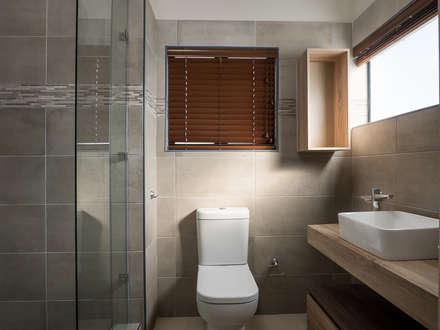 HOUSE DLAMINI: modern Bathroom by Première Interior Designs