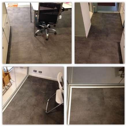 Posa in opera di pavimento in LVT: Complessi per uffici in stile  di Soloparquet Srl