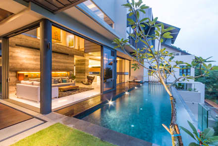Lap Pool overlooking the Living Room: modern Pool by MJKanny Architect