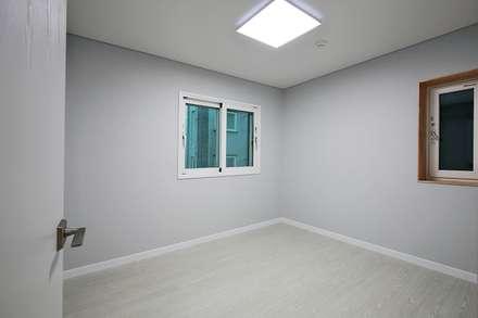 부산 강서구 명지동(명지지구 D3-2-12) 상가주택 신축공사: 피앤이(P&E)건축사사무소의  방