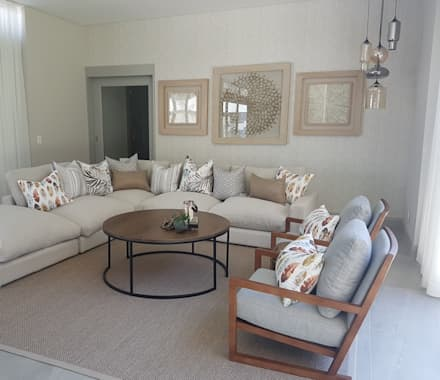 Copper & Grey Tones: modern Living room by Sophistique Interiors