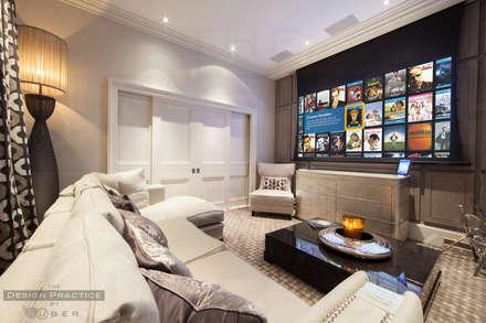 Sitting room-cum-media room: modern Media room by The Design Practice by UBER