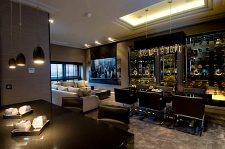 Apartment TV media wall and drop-down cinema: modern Media room by The Design Practice by UBER