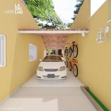 كراج يتسع لسيارتين تنفيذ Ladrilho Urbanismo e Arquitetura