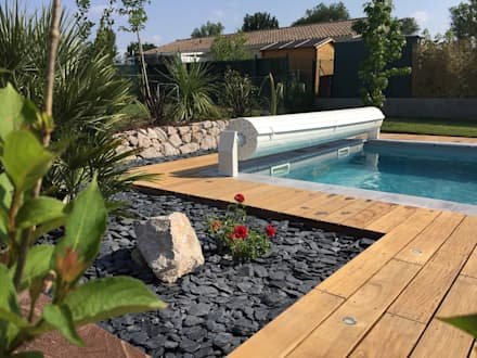 Piscine de 8x4m + terrasse en bois: Piscines  de style  par Oplus piscines